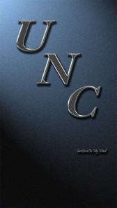 UNC Wallpaper Metal Letters Staggered on Lit Wall 1080 x 1920